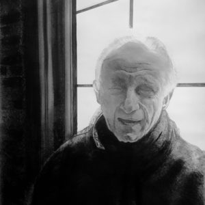 Man in front of a window