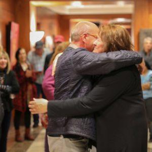 Opening reception hug